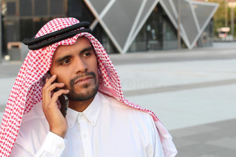 Middle eastern businessman on the phone royalty free stock photo