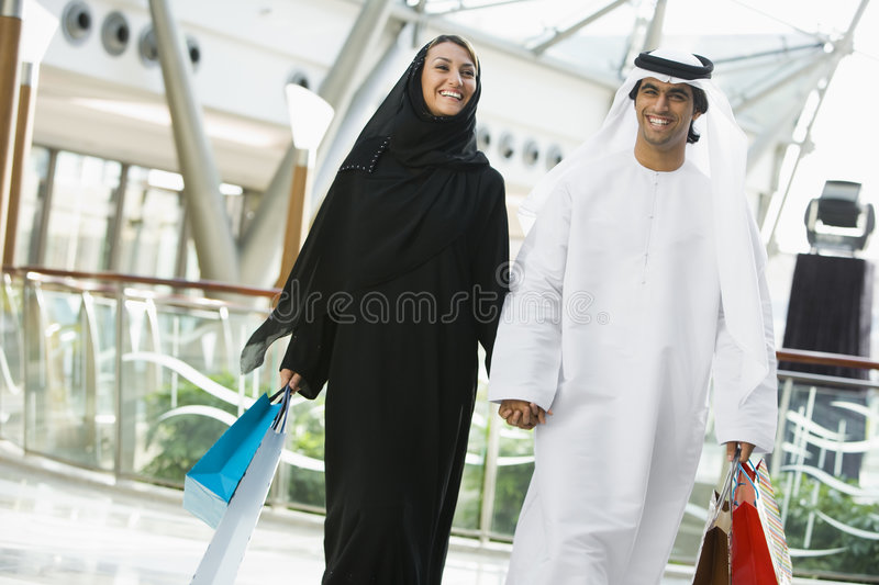 A Middle Eastern couple in a shopping mall royalty free stock photo