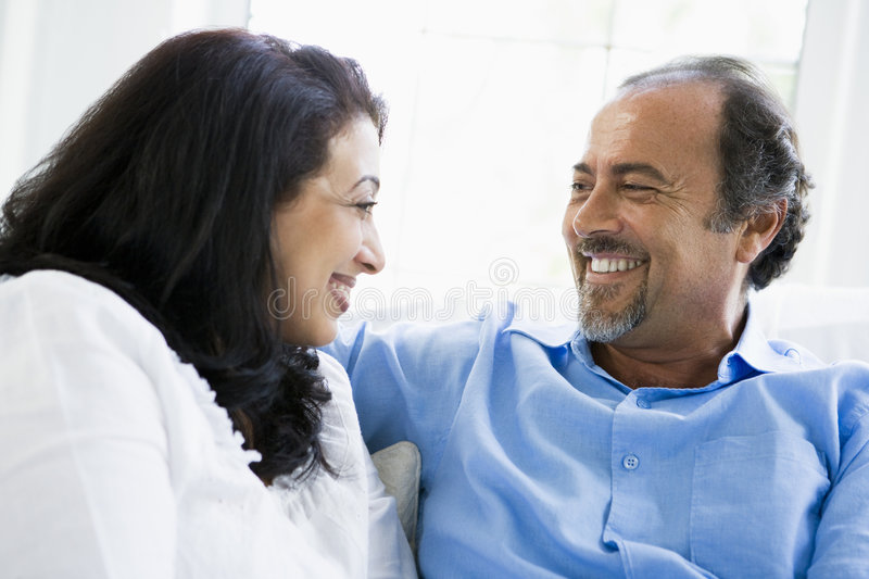 A Middle Eastern couple sitting at home stock photos