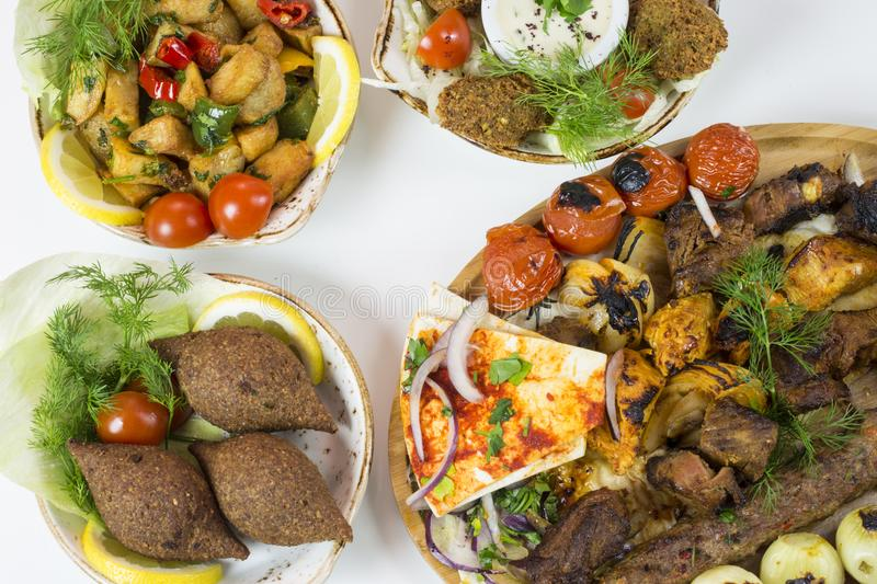 Middle eastern dishes served in restaurant stock images
