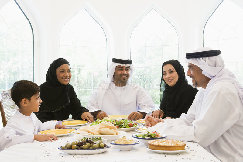Download A Middle Eastern Family Enjoying A Meal Stock Photo - Image: 6079136