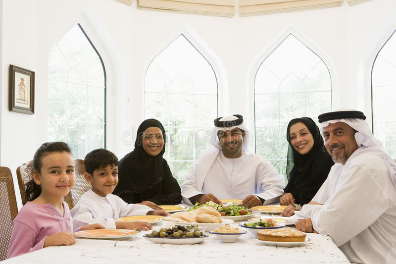 A Middle Eastern family enjoying a meal royalty free stock images