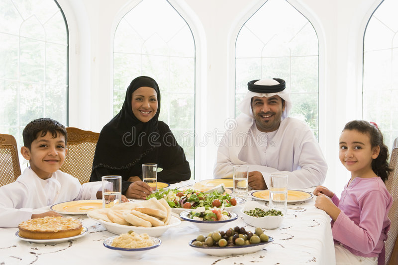 A Middle Eastern family enjoying a meal stock photos