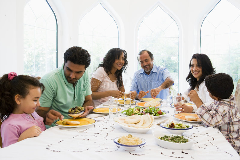 A Middle Eastern family enjoying a meal together.  stock photography