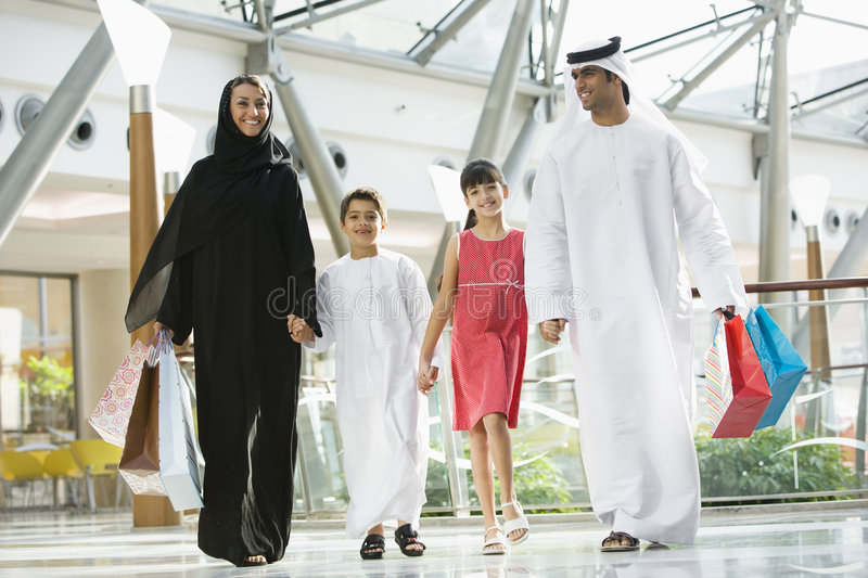 A Middle Eastern family in a shopping mall stock photography