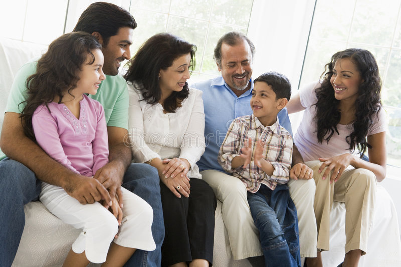Middle Eastern family sitting together. A Middle Eastern family sitting together on a couch royalty free stock photos