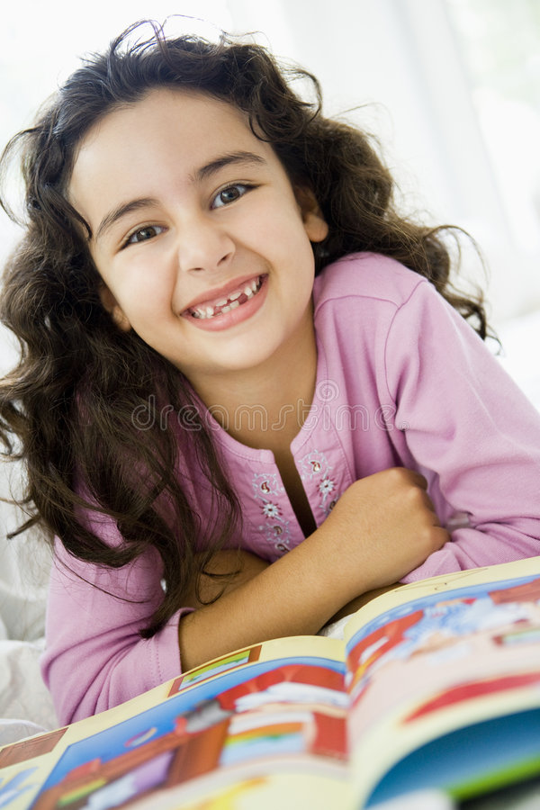 Middle Eastern girl reading. A Middle Eastern girl reading a book stock image