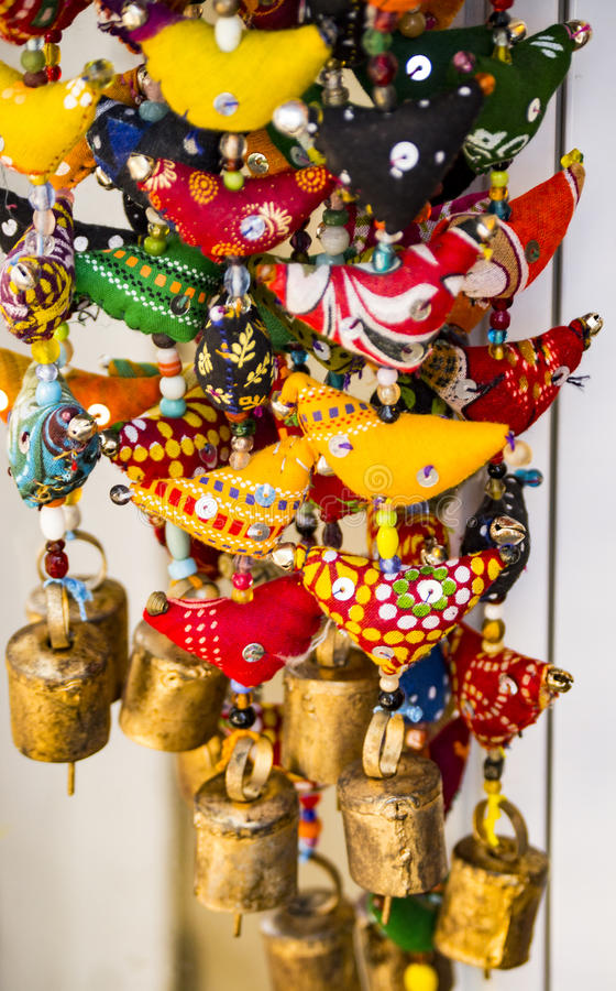 Middle Eastern Jingle. Textiled Middle Eastern Wind Chime. Vibrant and saturated color with playful textile pattern and tiny bells at the bottom royalty free stock photography