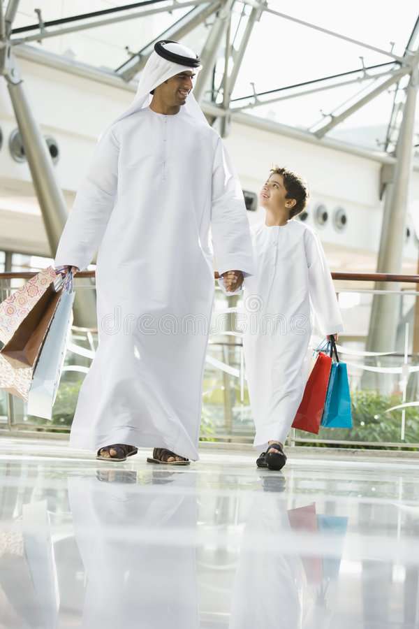 Download A Middle Eastern Man And His Son Shopping Stock Photo - Image of smiling, recreation: 6080080