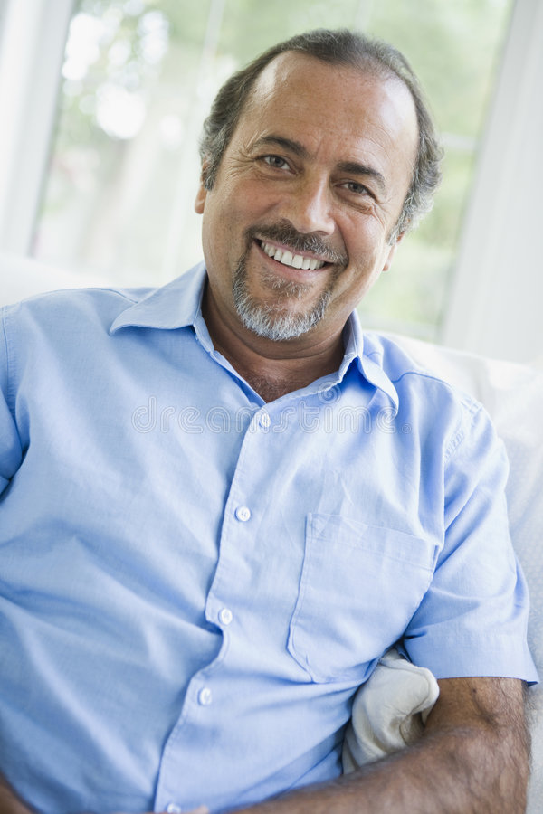 A Middle Eastern man at home. Smiling at camera royalty free stock images