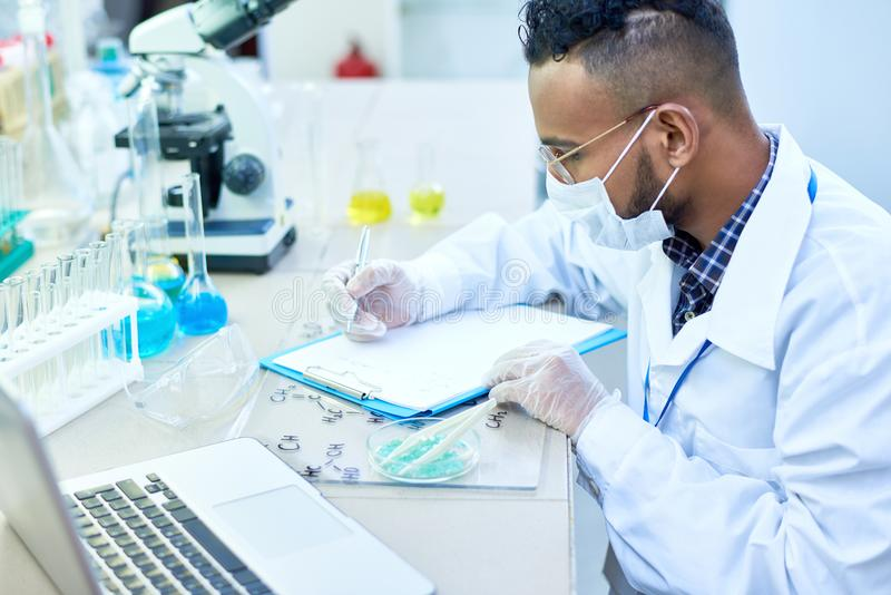 Middle-Eastern Scientist Working in Lab stock images