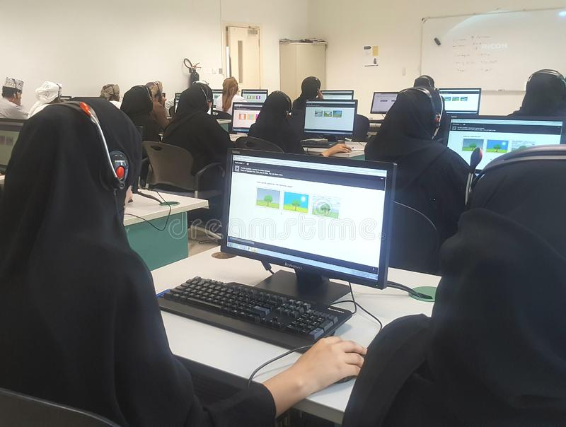 Middle Eastern students in a computer lab stock images