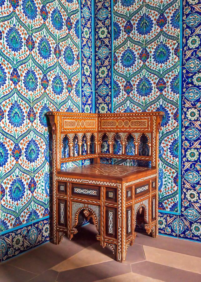Middle Eastern Corner Chair, Sledmere House, Yorkshire,. A Middle Eastern style corner armchair inlaid with mother-of-pearl and ivory on display in the Turkish stock image