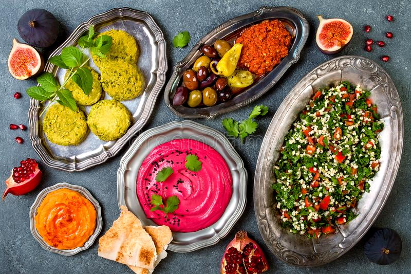 Middle Eastern traditional dinner. Authentic arab cuisine. Meze party food. Top view, flat lay royalty free stock photography