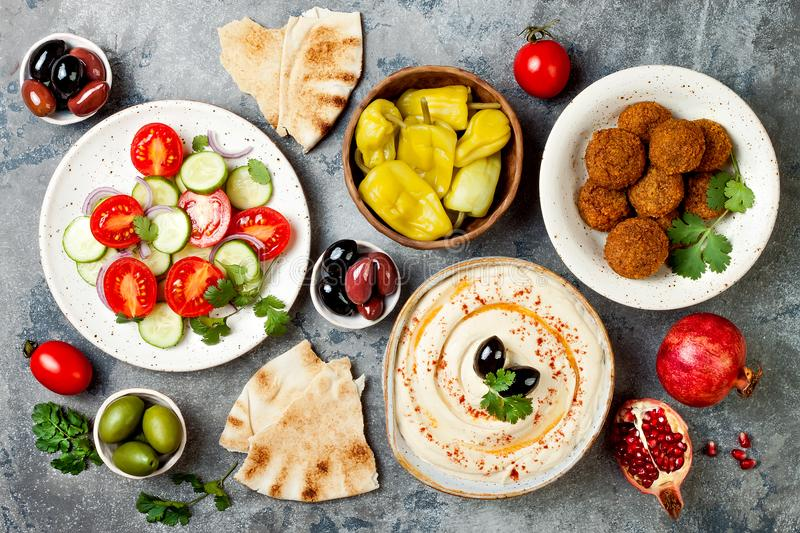 Middle Eastern traditional dinner. Authentic arab cuisine. Meze party food. Top view, flat lay, overhead. stock images
