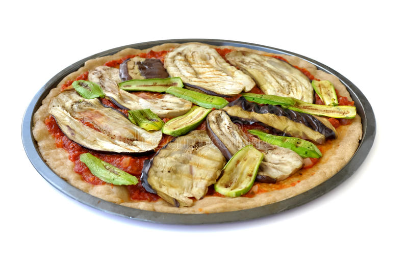 Middle eastern vegetarian pizza. Eggplant and zucchini slices, baked and placed as ingredients in a vegetarian pizza and topped afterwards with cheese; usually stock photography