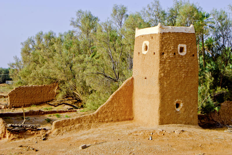 Middle-Eastern Watchtower and Wall Ruins Made of Mud stock photography