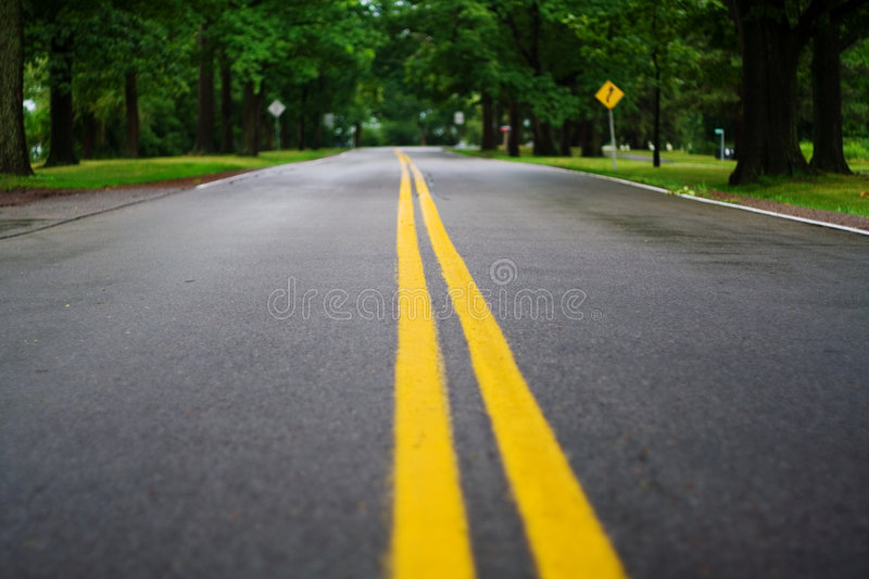 Middle of the Road. Standing in the middle of the road on a rainy day stock photography