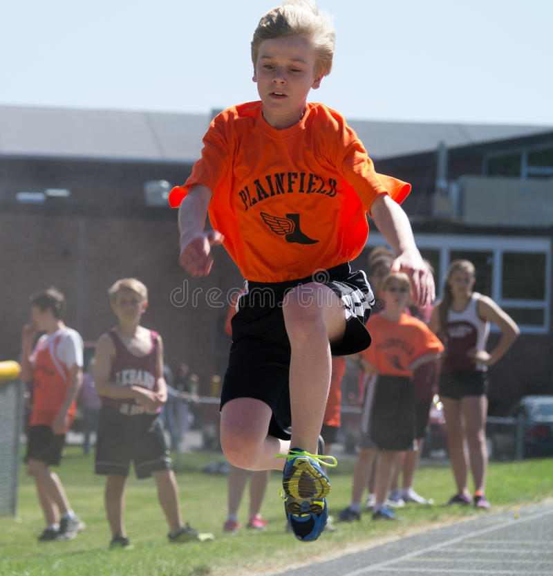 Middle school track long jump royalty free stock photography
