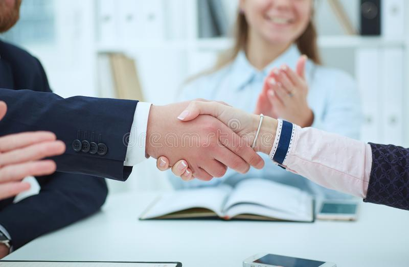 Middle section of business people shaking hands, finishing up a meeting. Concept of successful team work stock photos