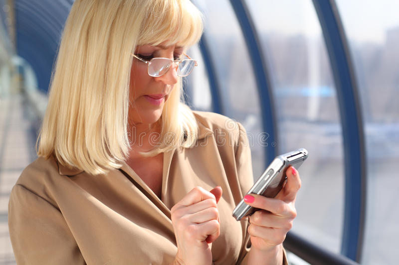 Middleaged Woman In Glasses Look On Pda Stock Images