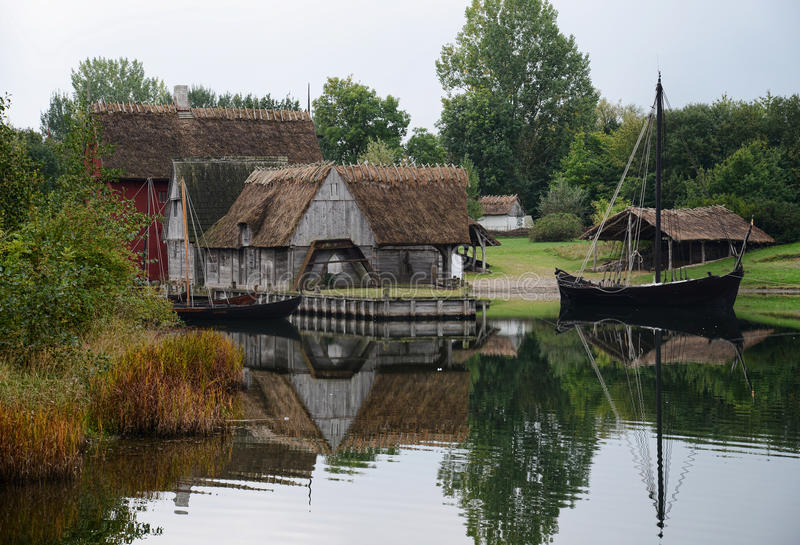 From the middleages. Reconstruction of a small habour and village stock photography