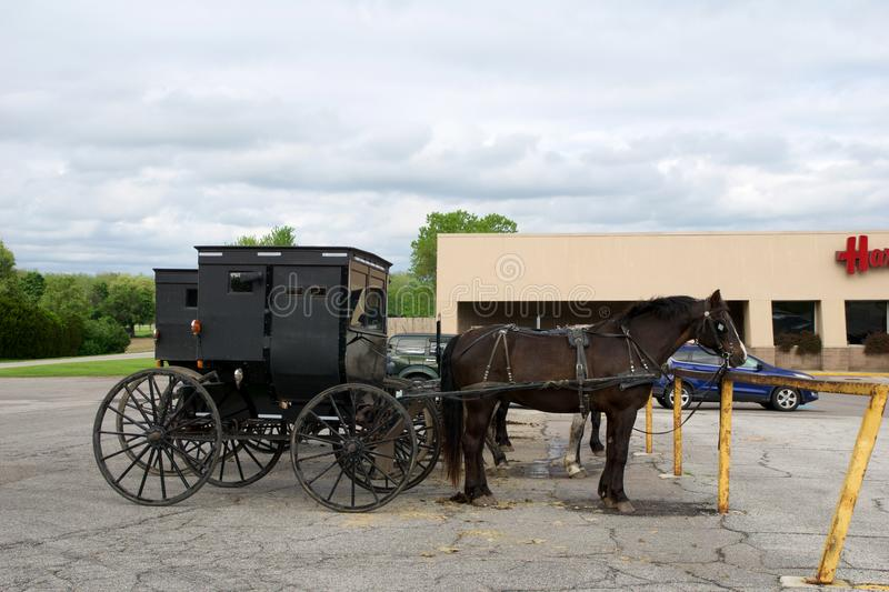 MIDDLEBURY, INDIANA, UNITED STATES - MAY 22nd, 2018: View of amish carriage along the city, known for simple living with royalty free stock image