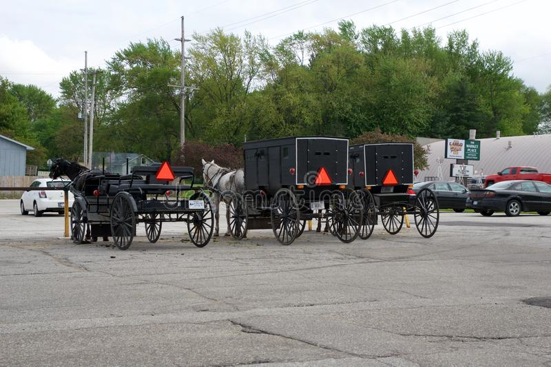 MIDDLEBURY, INDIANA, UNITED STATES - MAY 22nd, 2018: View of amish carriage along the city, known for simple living with. Touch of nature contacy, plain dress stock image