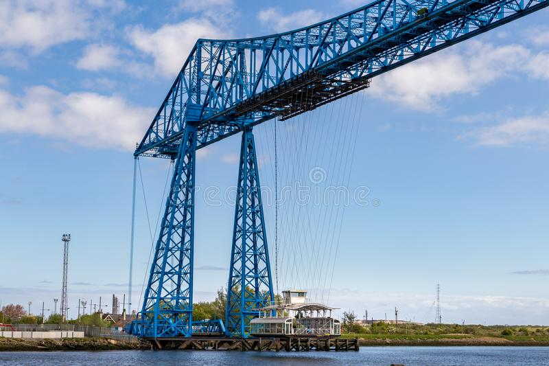 Transporter Bridge, Middlesbrough, UK. Middlesbrough, England, UK - May 14, 2016: View towards the transporter bridge with a gondola passing the River Tees stock photo