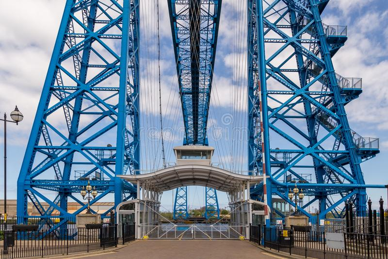 Transporter Bridge, Middlesbrough, UK. Middlesbrough, England, UK - May 14, 2016: View towards the transporter bridge with a gondola passing the River Tees stock image