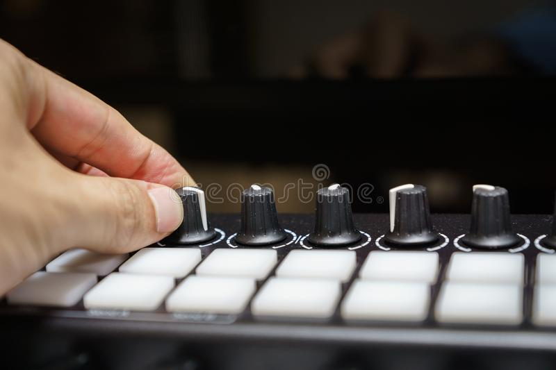 MIDI keyboard synthesizer knobs and pads stock images