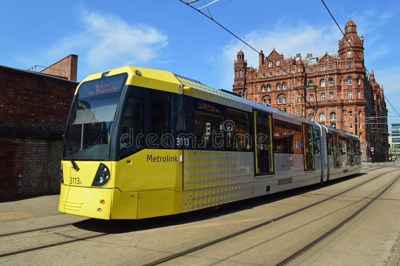 Midland Hotel Manchester with yellow metro link tram in foreground. The Midland Hotel is a grand hotel in Manchester, England. pictured with yellow metro link royalty free stock photo