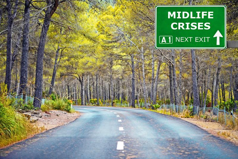 MIDLIFE CRISES road sign against clear blue sky stock photos