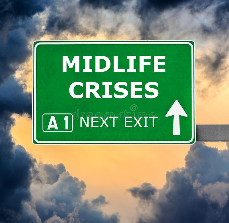 MIDLIFE CRISES road sign against clear blue sky royalty free stock images