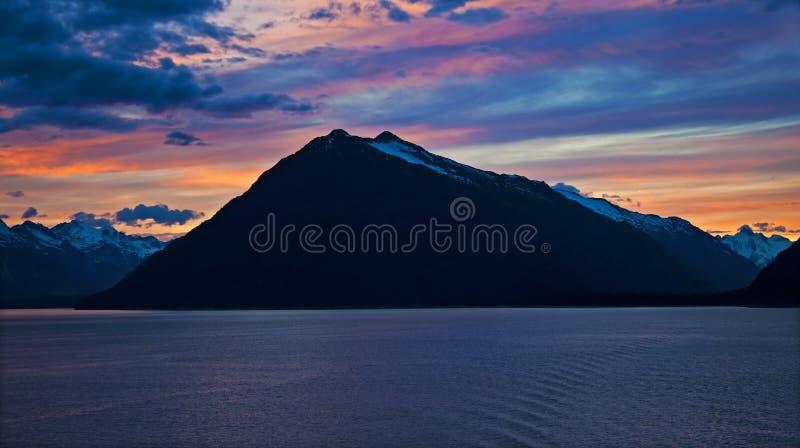 Midnight in Alaska. Nighttime color along the Inside Passage west of Skagway, Alaska royalty free stock photo