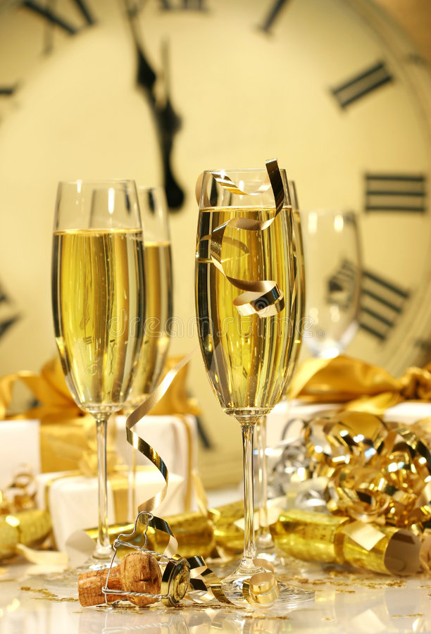 Midnight champagne for the New. Champagne glasses ready to bring in the New Year royalty free stock image