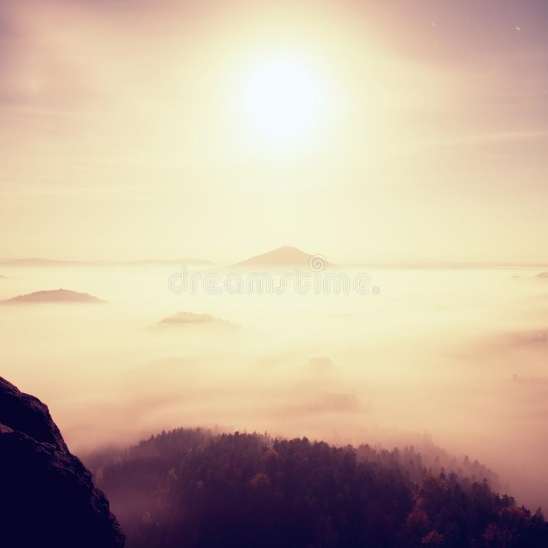Midnight. Full moon night in a beautiful mountain of Bohemian-Saxony Switzerland. Hilly peaks and trees increased from heavy fog stock photography