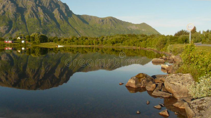 Midnight in a Lofoten's fjord. Fjord enlighted by the midnight's sun, Lofoten islands stock photography