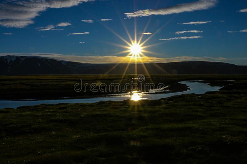 Midnight sun in the arctic stock photo
