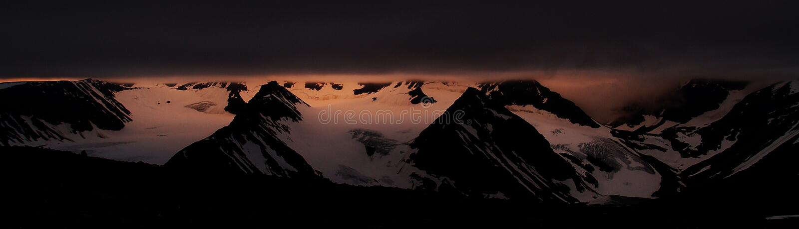 Midnight sun over the Kebnekaise peak royalty free stock image