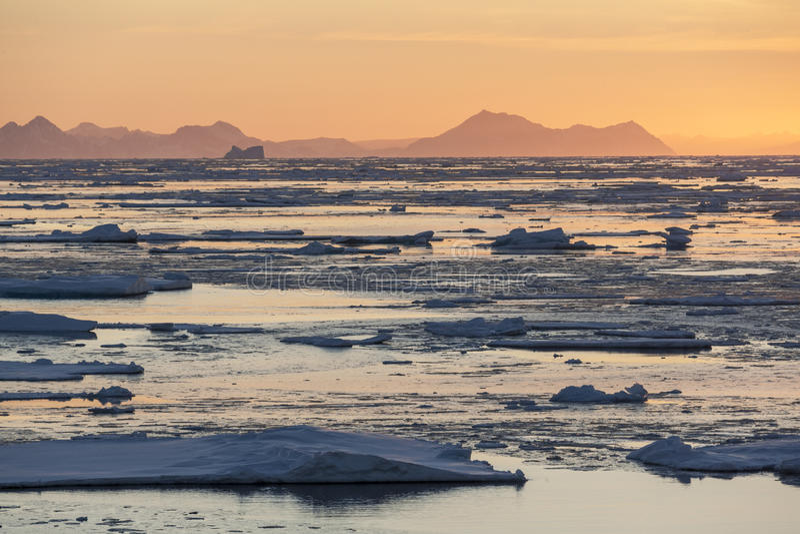 Midnight Sun - Sea Ice - Greenland royalty free stock photos