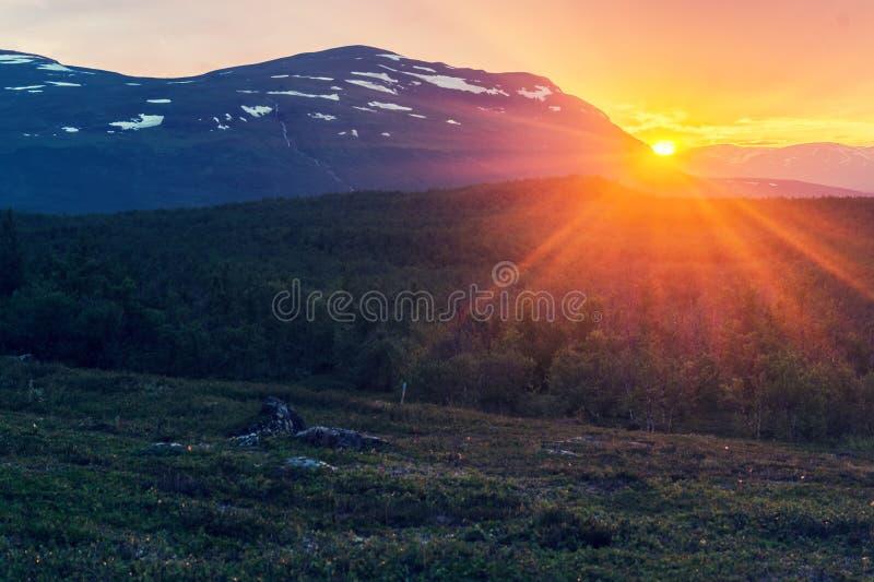 Midnight sun in summer in Abisko National Park, Sweden royalty free stock image