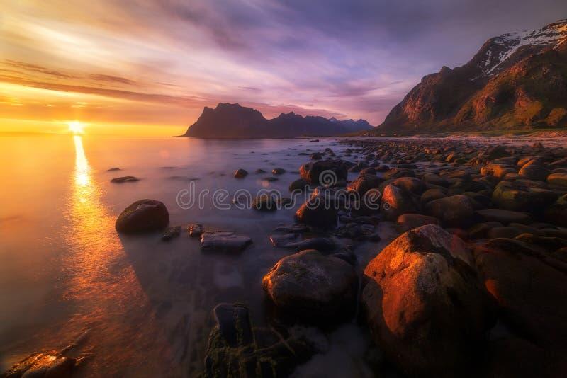 Midnight Sun. Taken over the beautiful Uttakleiv beach in the arctic Lofoten, Norway stock image