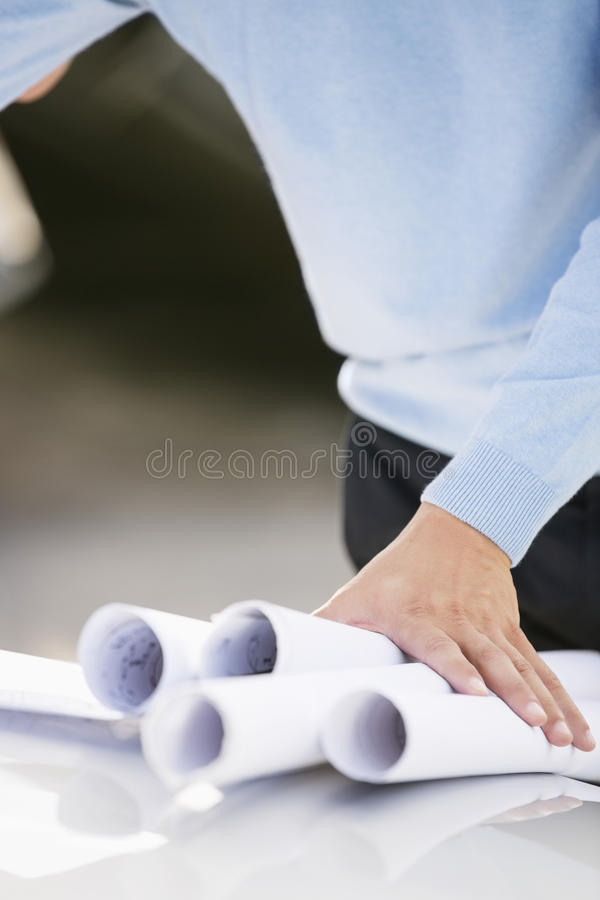 Midsection of architect with blueprints royalty free stock photos