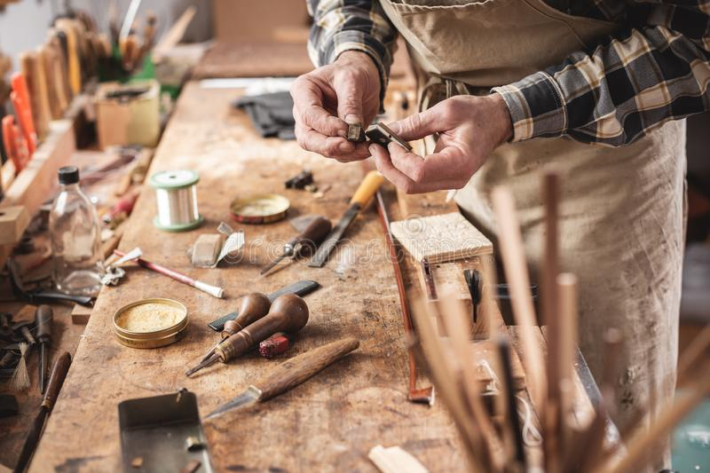 Craftsman next to a rustic workbench royalty free stock photos