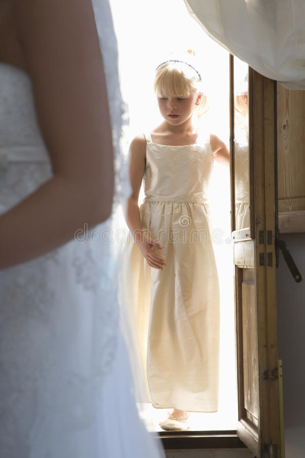 Midsection Bride With Girl Entering House In Background royalty free stock image