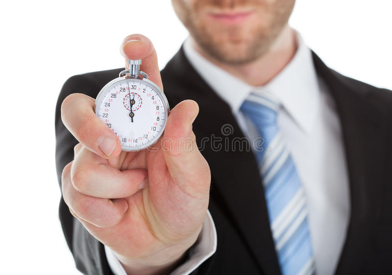 Midsection of businessman showing stopwatch royalty free stock image