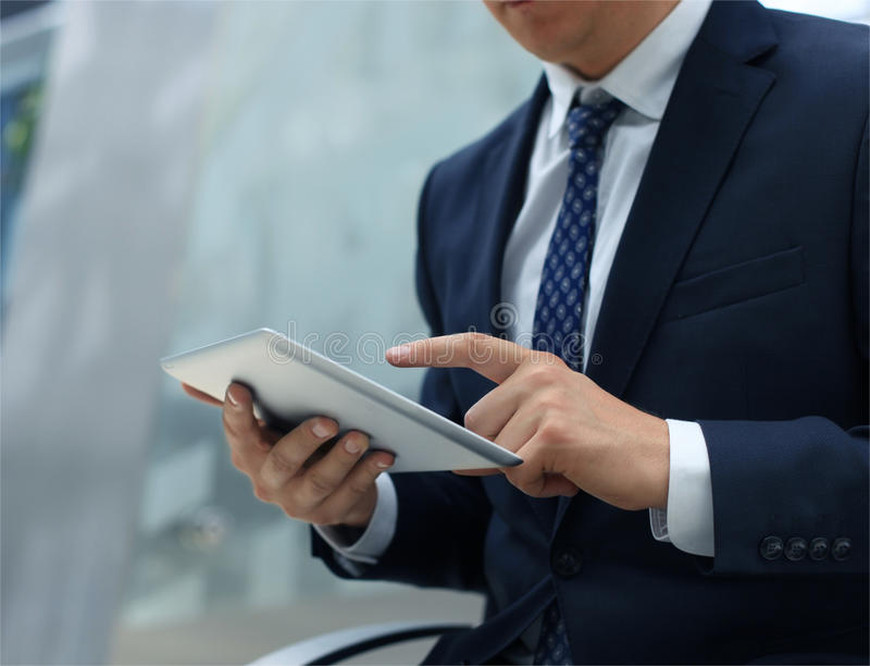 Midsection of businessman using digital tablet stock photos
