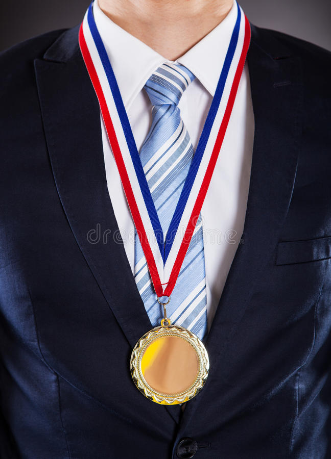 Midsection of businessman wearing medal stock photography