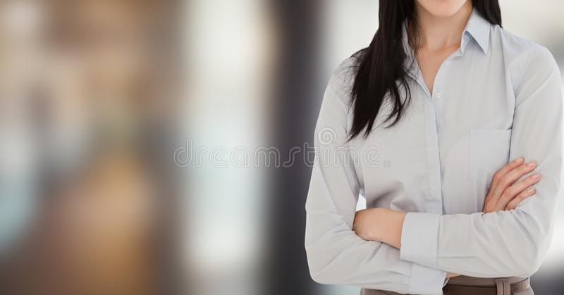 Midsection of businesswoman with arms crossed royalty free stock photo